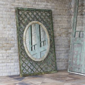 Aged Metal Lattice With Oval Mirror