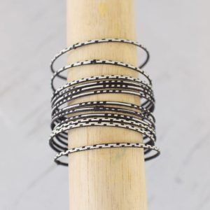 Set Of 12 Braided Black And White Cana Flecha Bangles