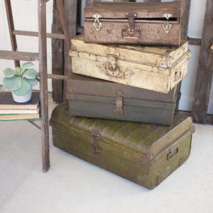 Set Of Four Rustic Metal Antique Suit Cases