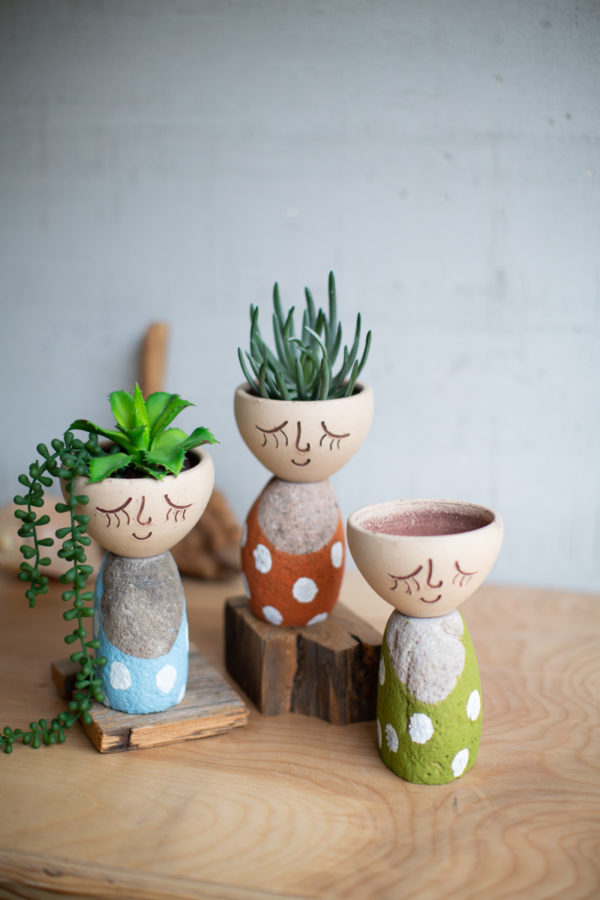 Set Of Three Clay Face Planters With River Rock Pace