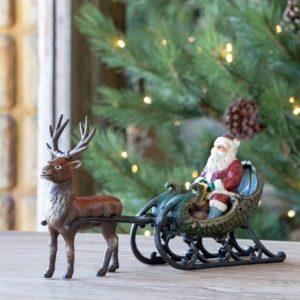 Cast Iron Santa In Reindeer Drawn Sleigh